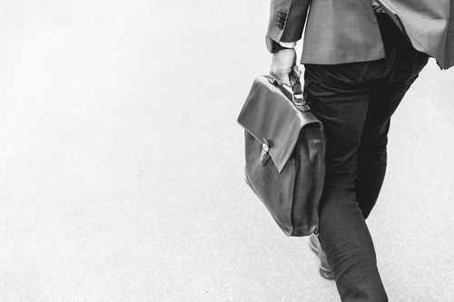 Man Carrying Briefcase Bw Web